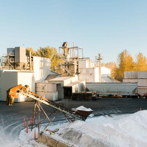 The Supreme Perlite Factory with a crane full of perlite